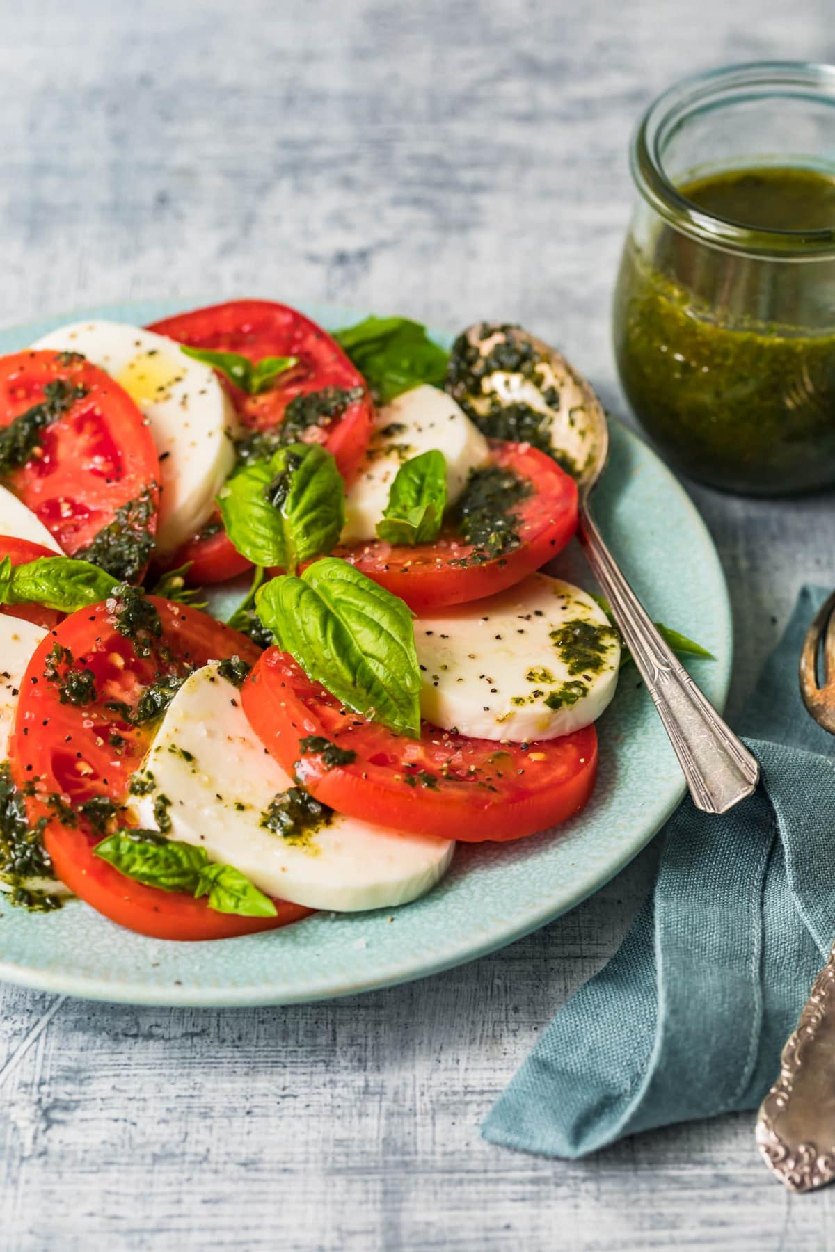Tomato and mozzarella salad with basil dressing on top
