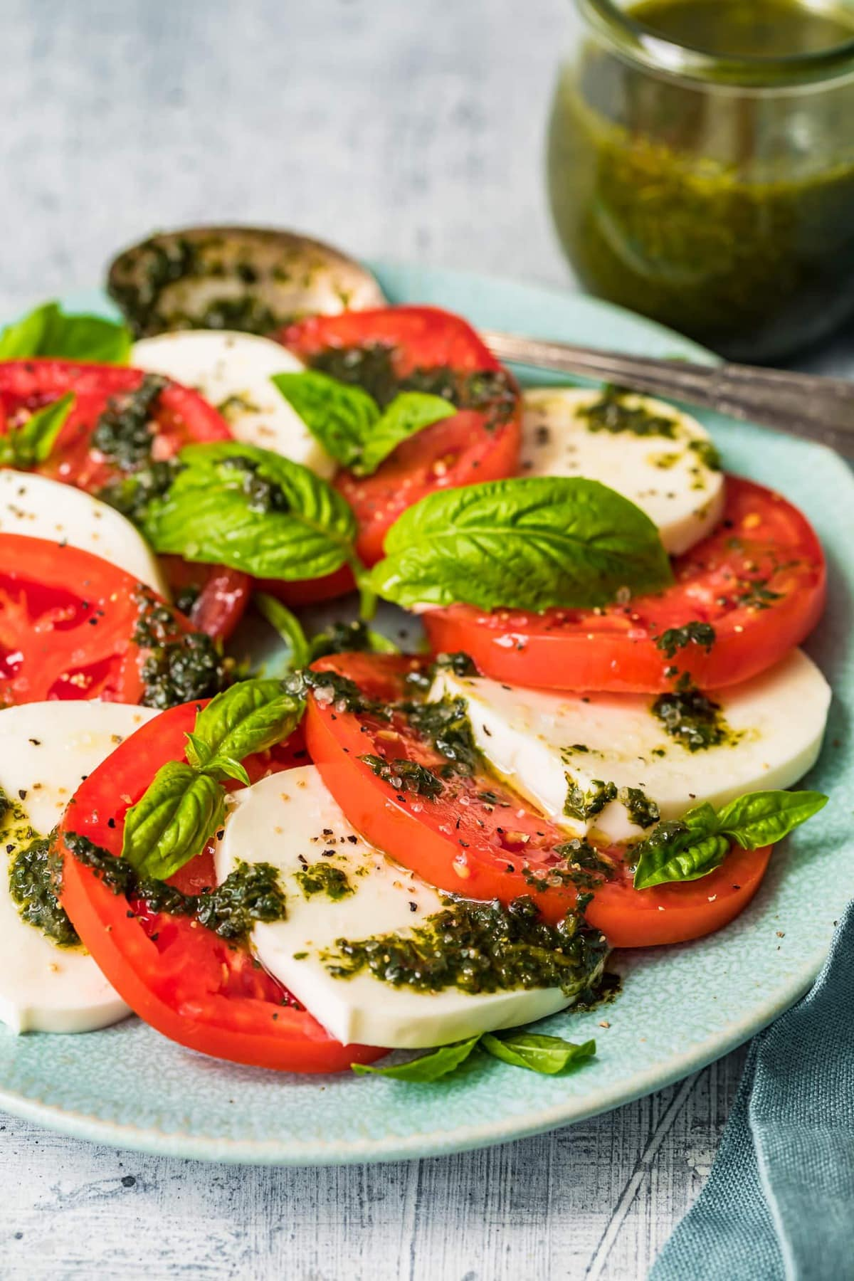 The best caprese salad dressed with fresh basil leaves