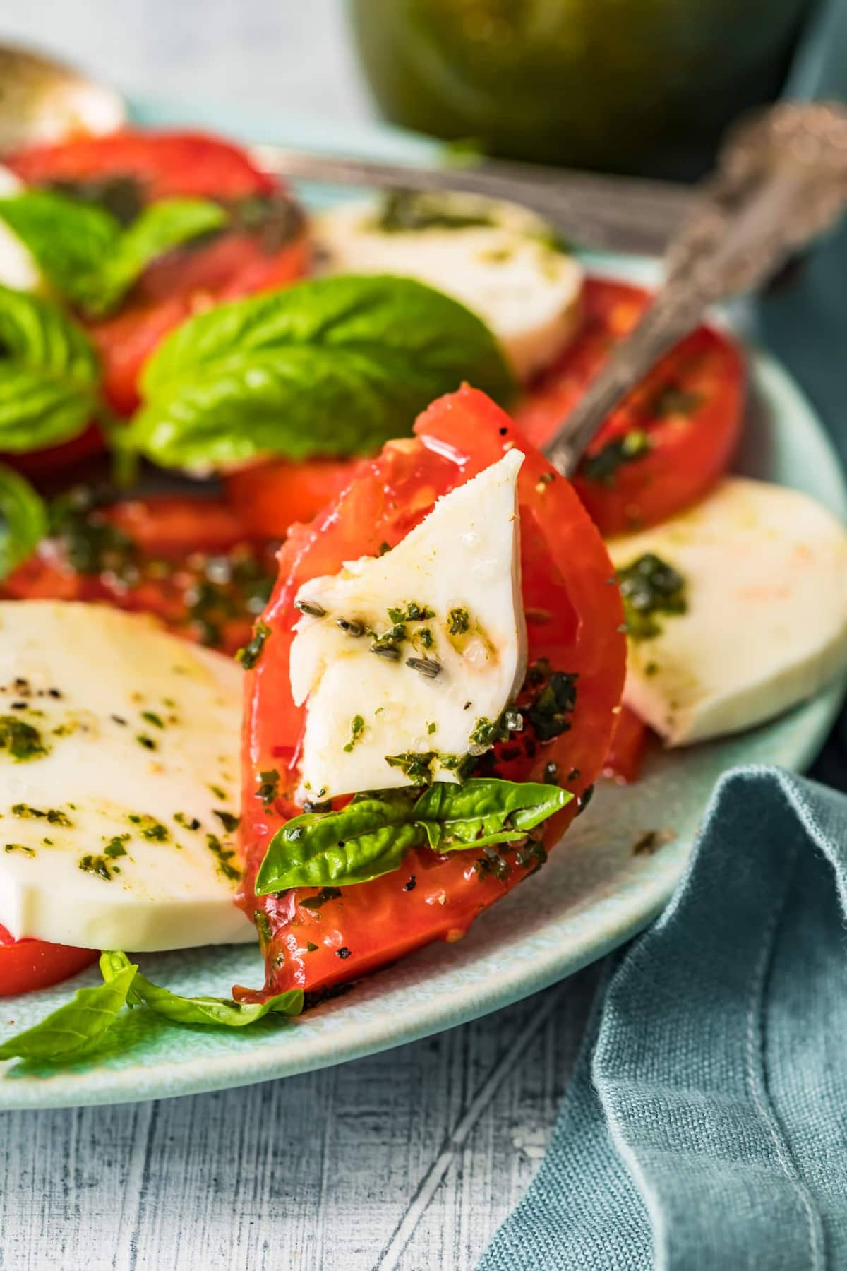 Tomato, mozzarella and basil on a fork