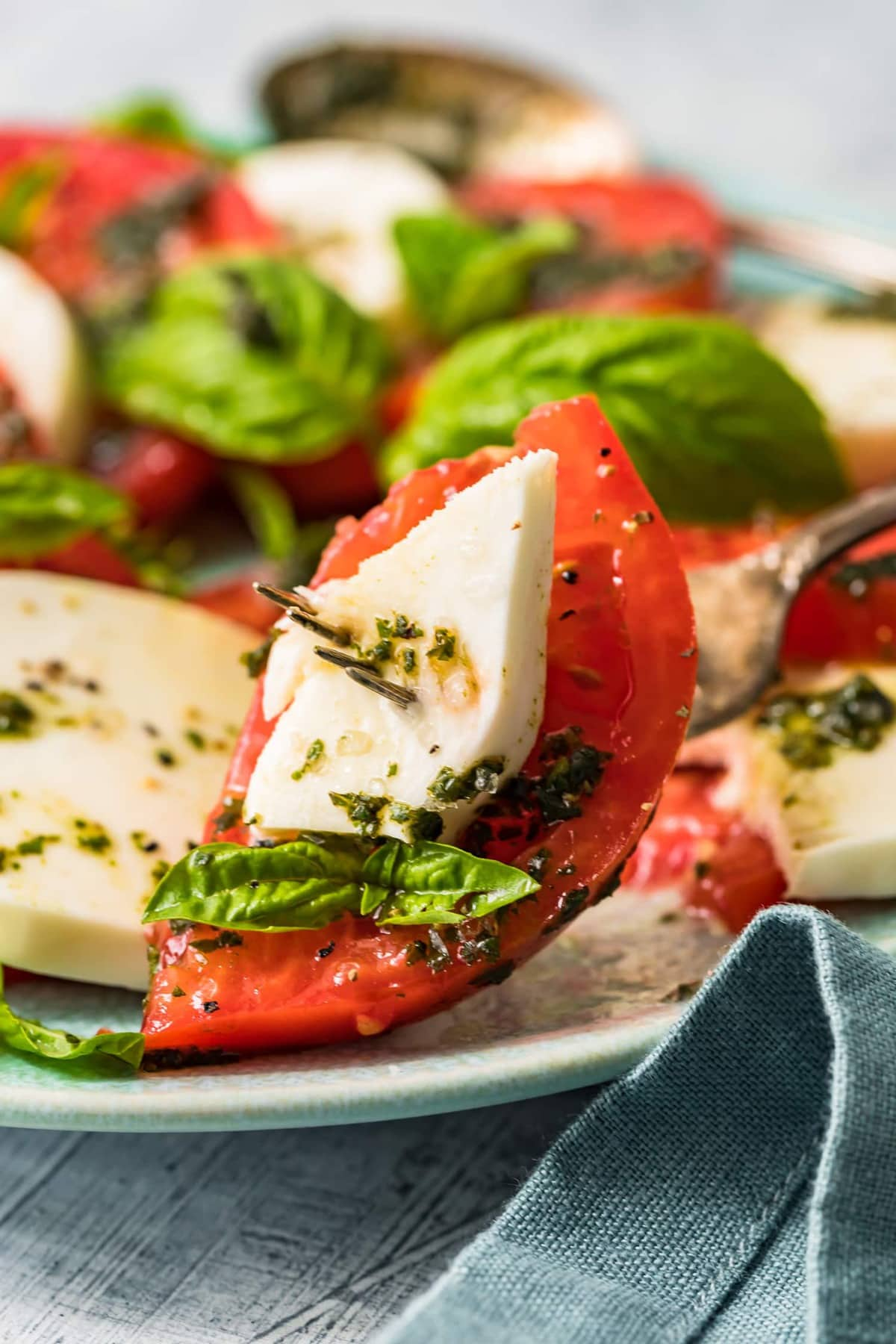 Close up of caprese salad on a fork