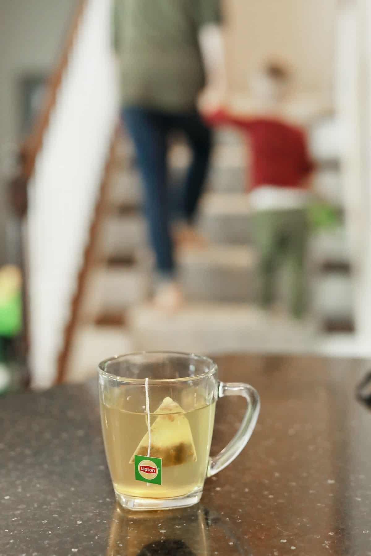 a glass mug of lipton tea