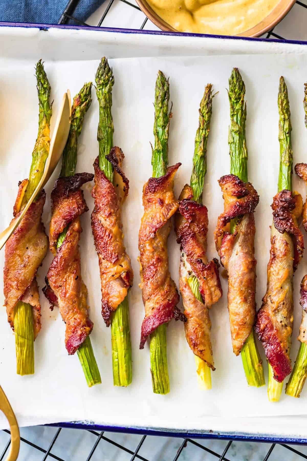 Bacon Wrapped Asparagus in a white tray