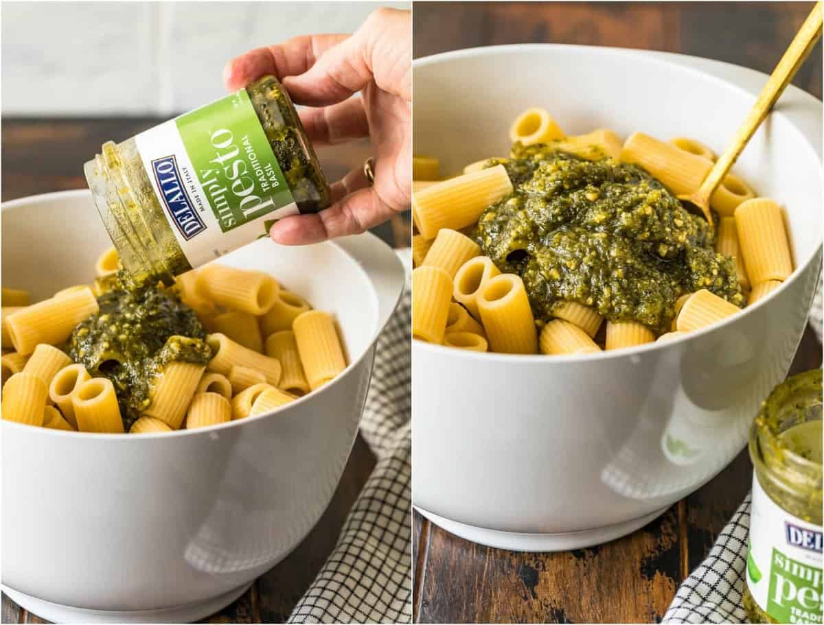 Pesto being poured and mixed into the pasta