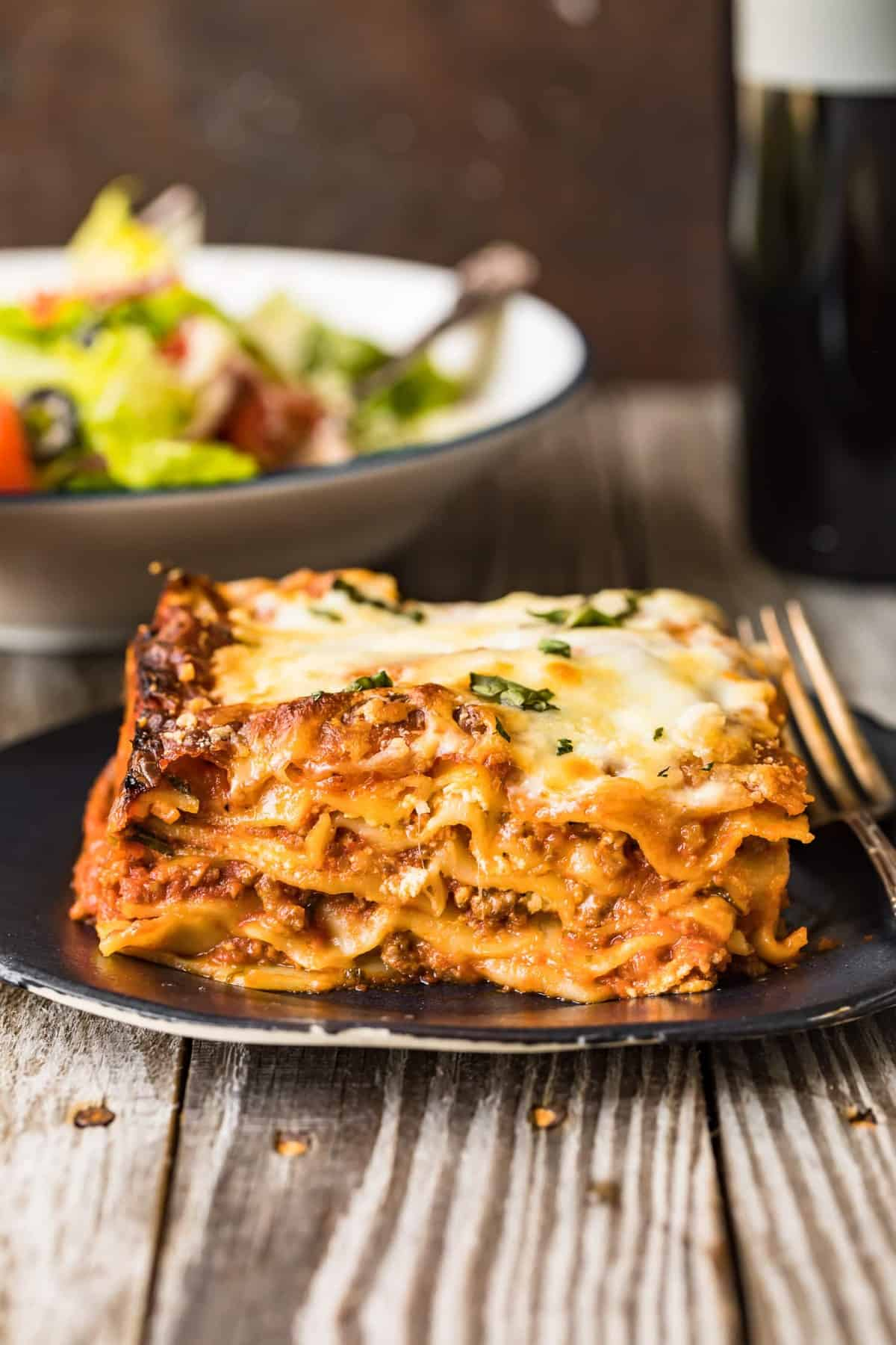 Lasagna served on a blue plate