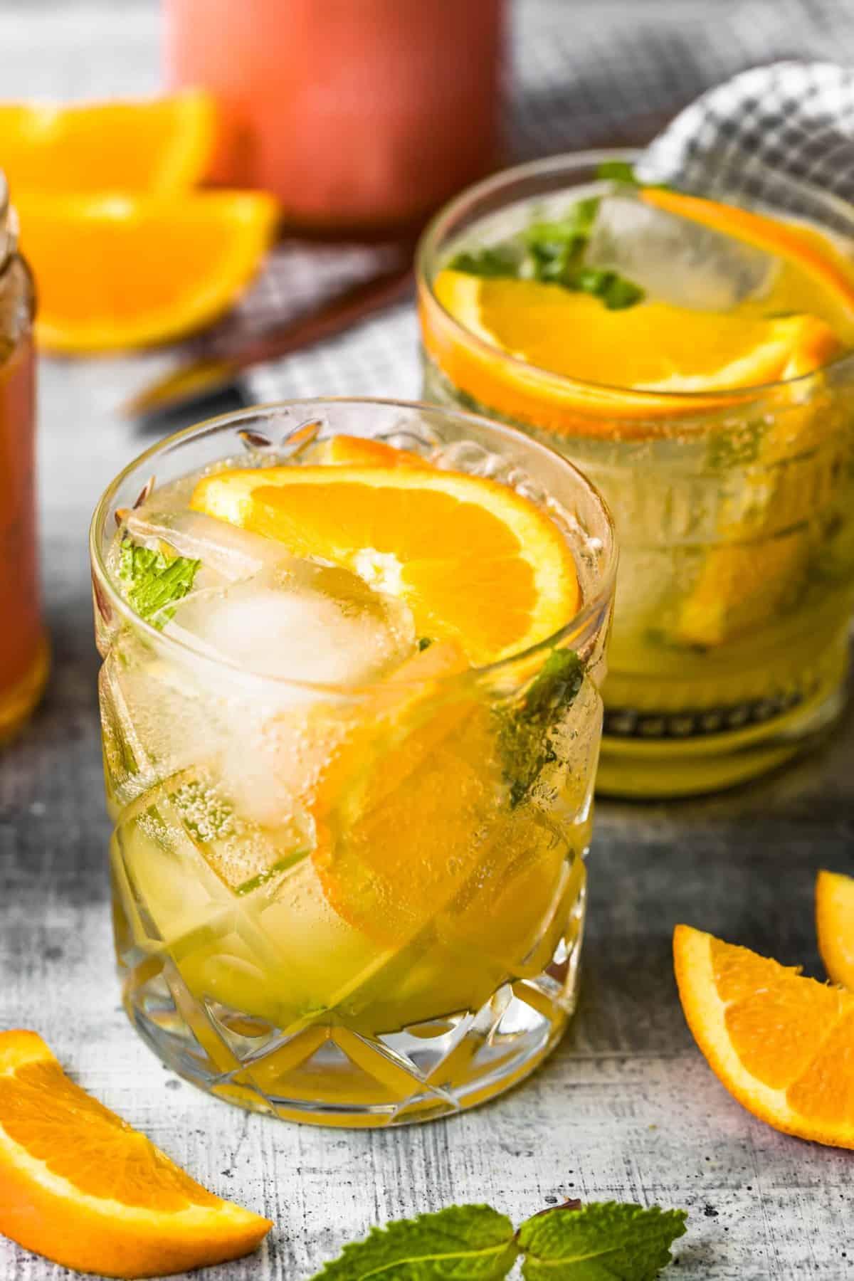 up top shot of cocktails garnished with sliced citrus fruit