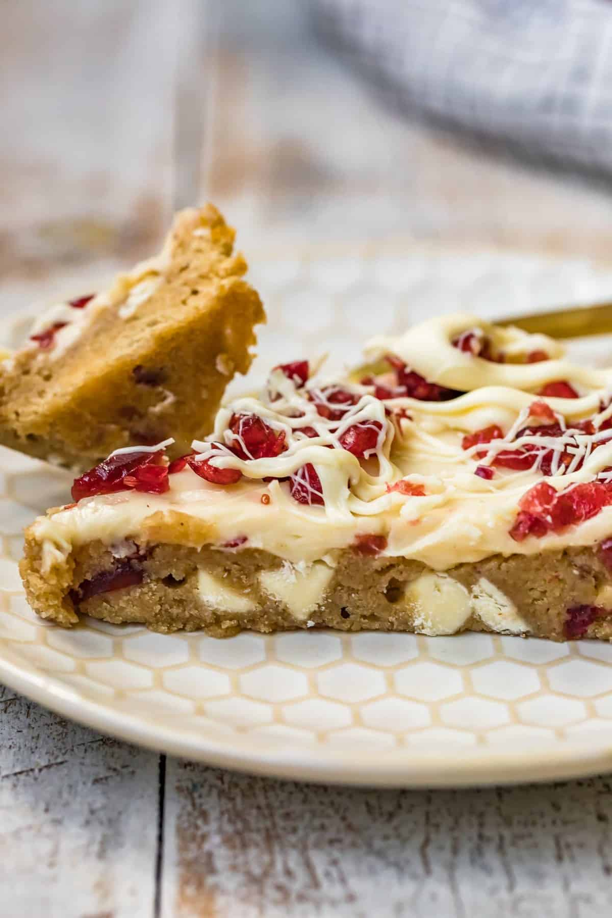 details showing cranberry bliss bars on a plate