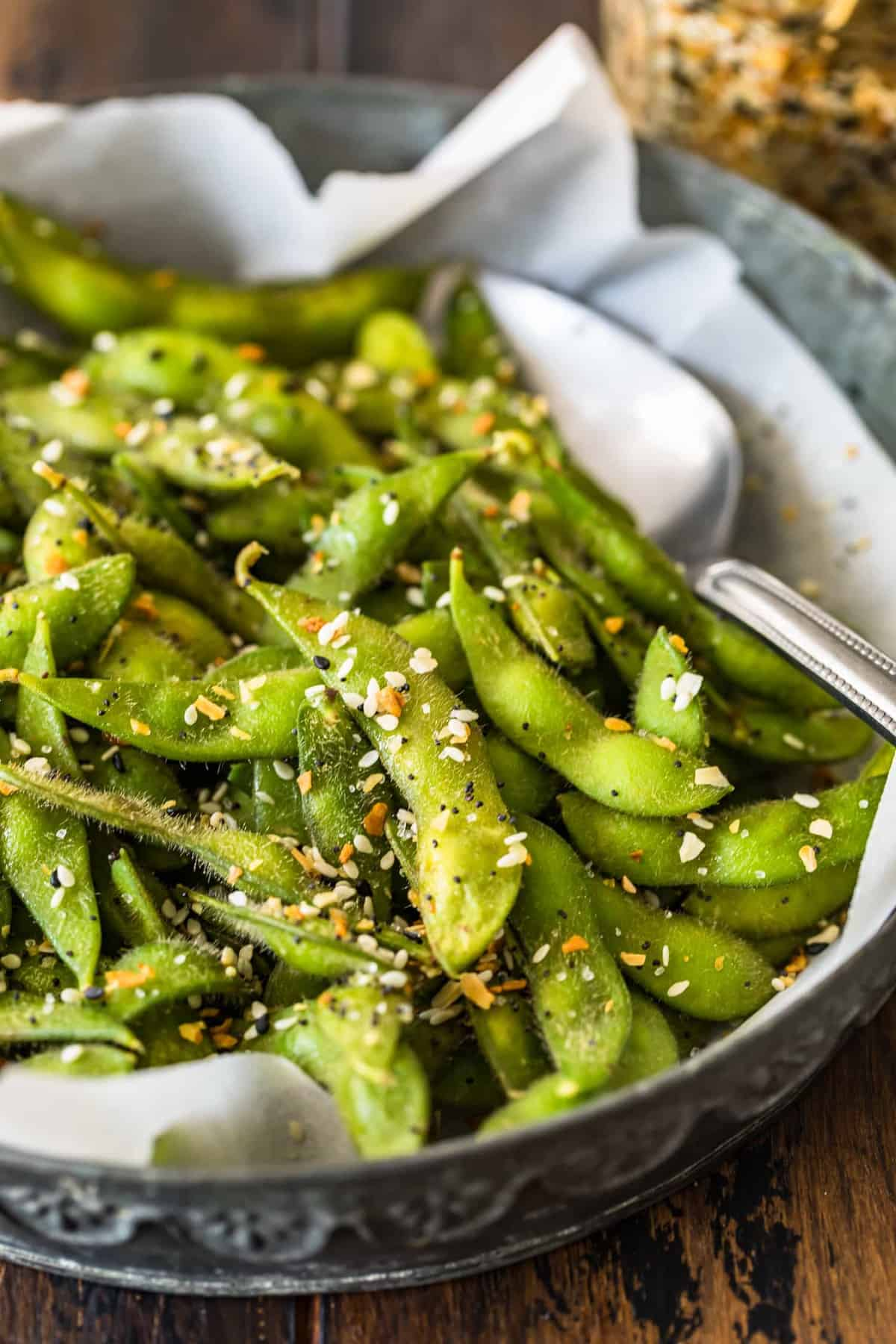 A close up view of edamame with spoon