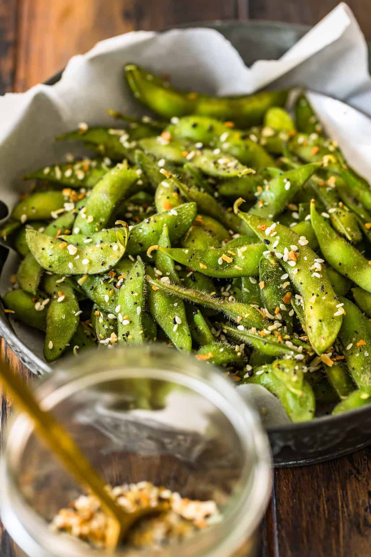 A close up view of bright green edamame seasoned well