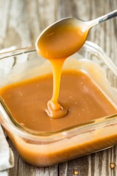 caramel falling from spoon into dish