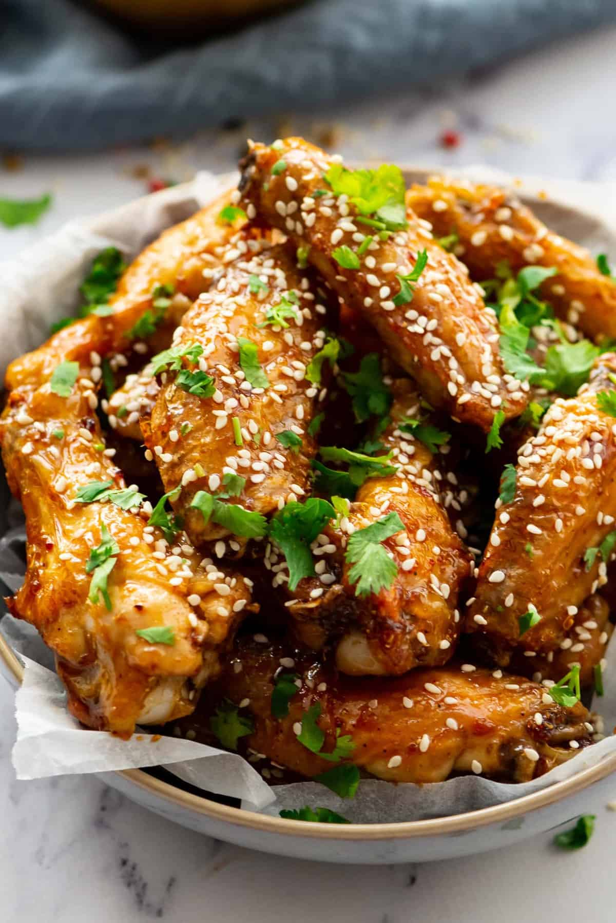 Honey Glazed Chicken Wings sprinkled with sesame seeds and fresh cilantro