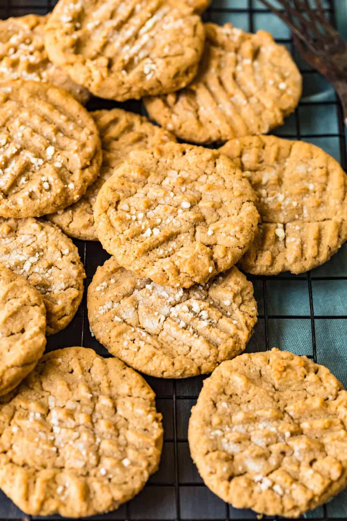 Peanut butter cookies piled on top of each other