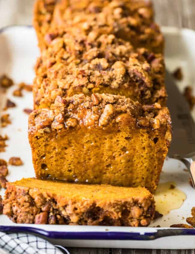 sliced loaf of oatmeal pumpkin bread on a plate