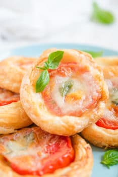 caprese tarts stacked on a plate