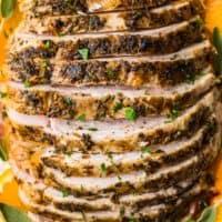 sliced crockpot turkey breast on plate