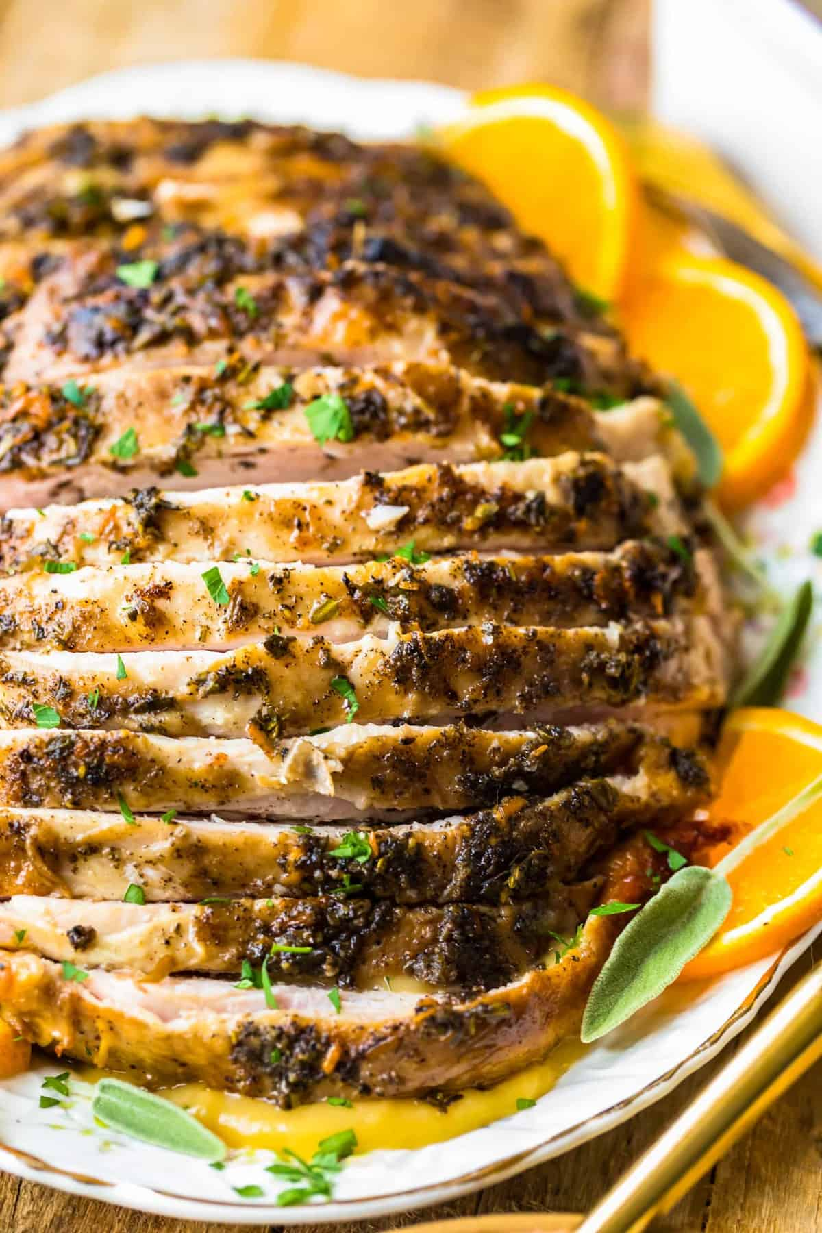 Sliced turkey breast with fresh herbs