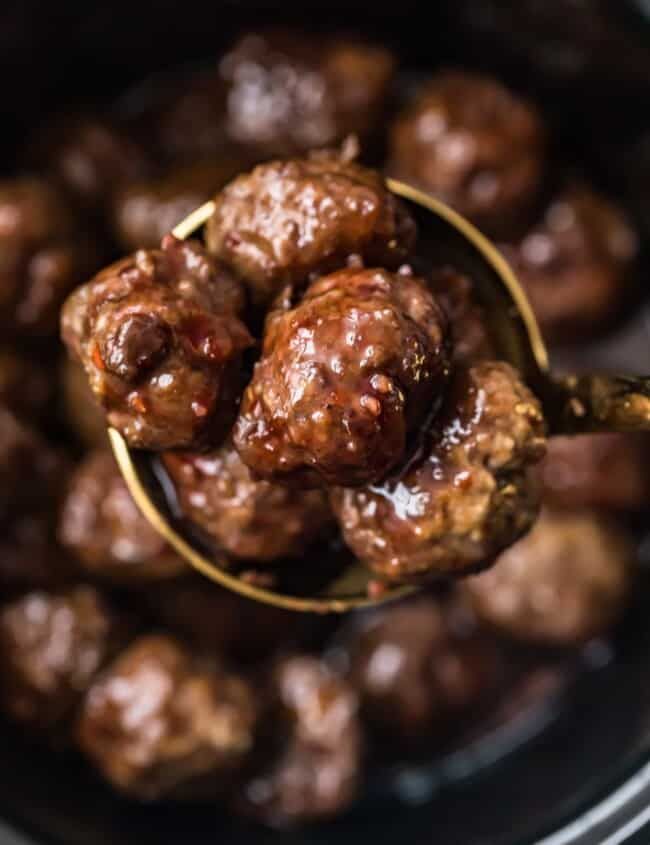 grape jelly meatballs in a spoon