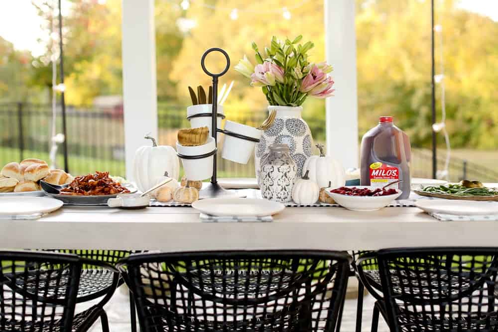 A table set with Thanksgiving Decor and Milos Sweet Tea