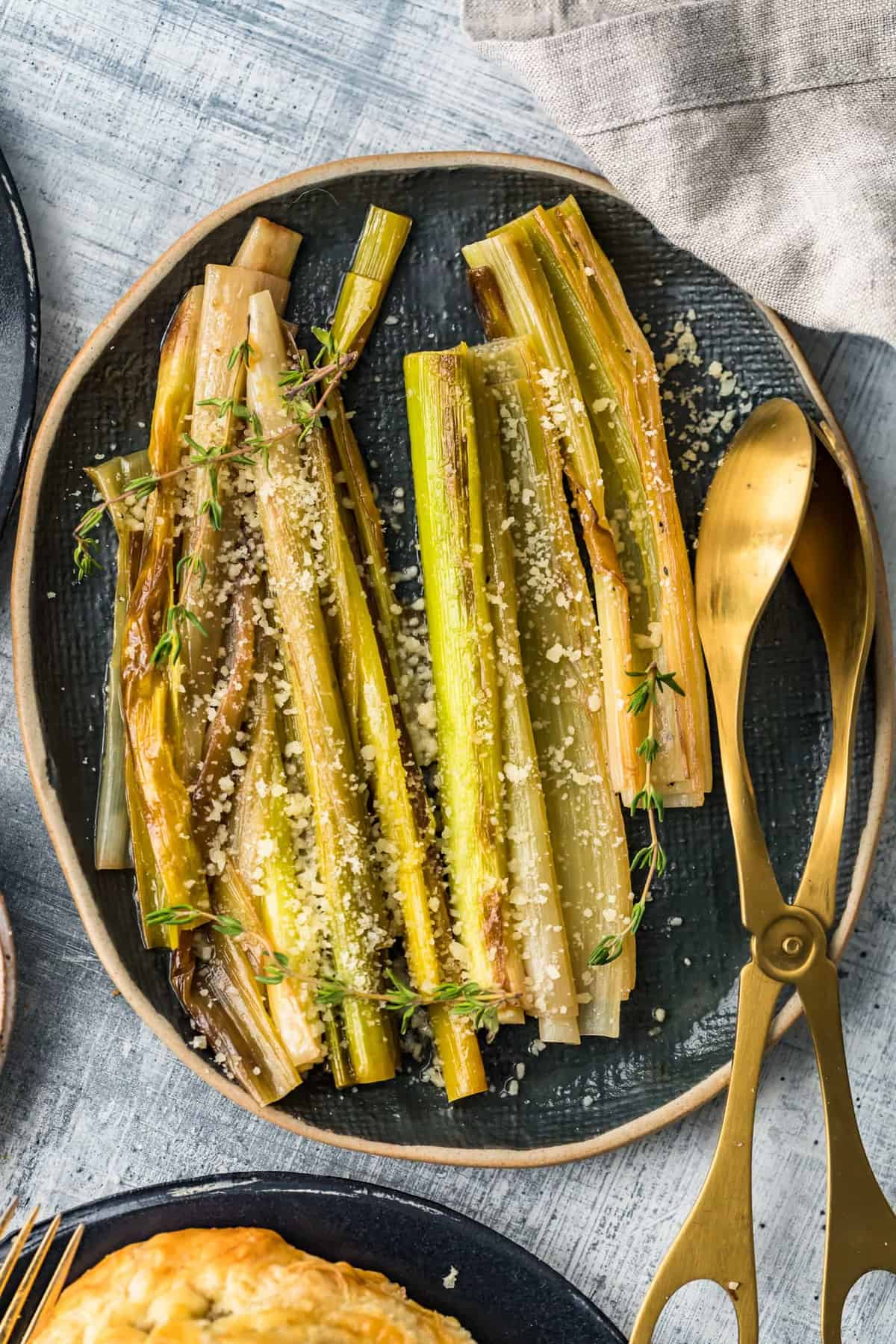 Sauteed Leeks with Parmesan on a black serving dish