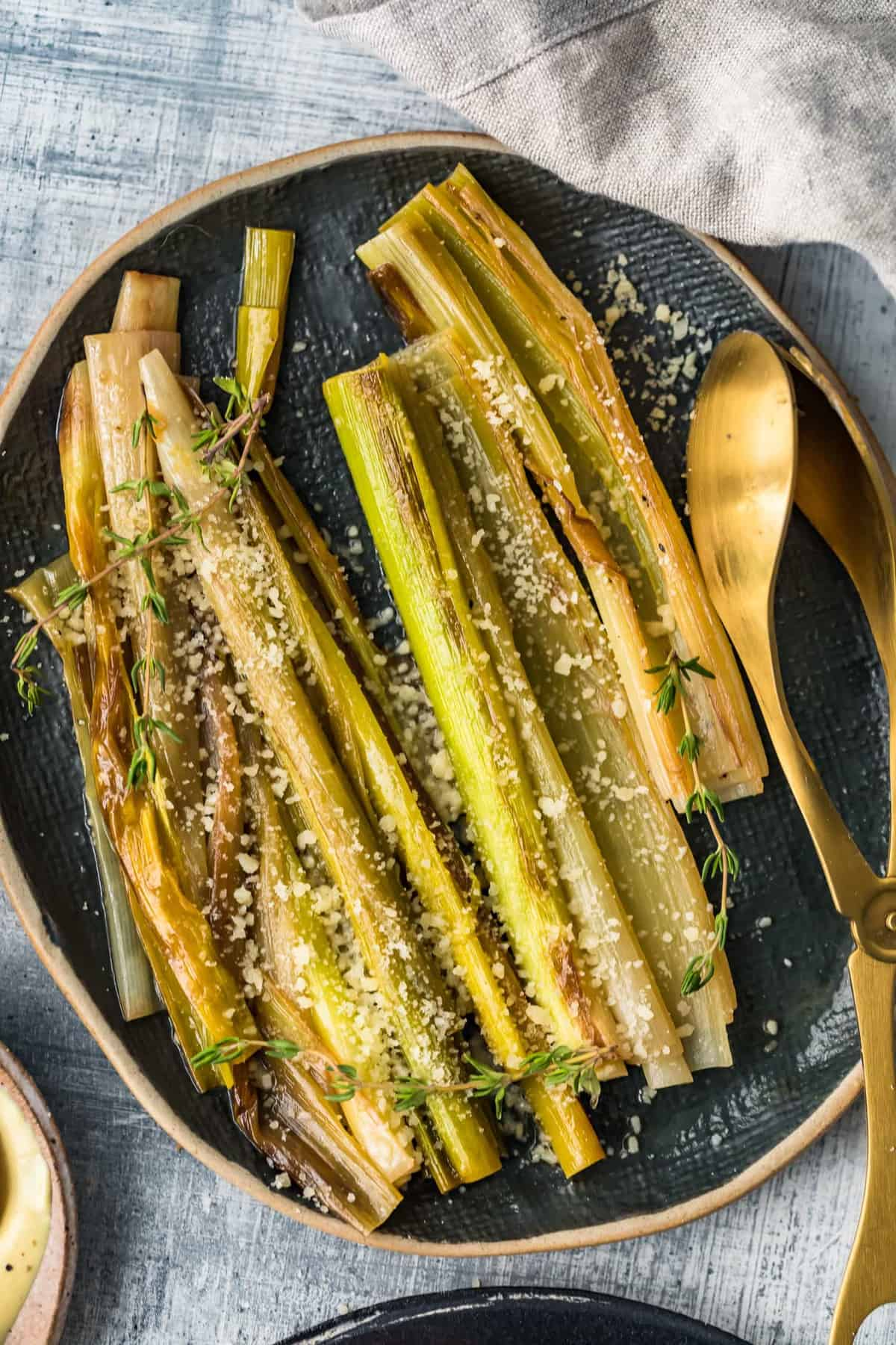 Close up of the sauteed leeks on a black plate
