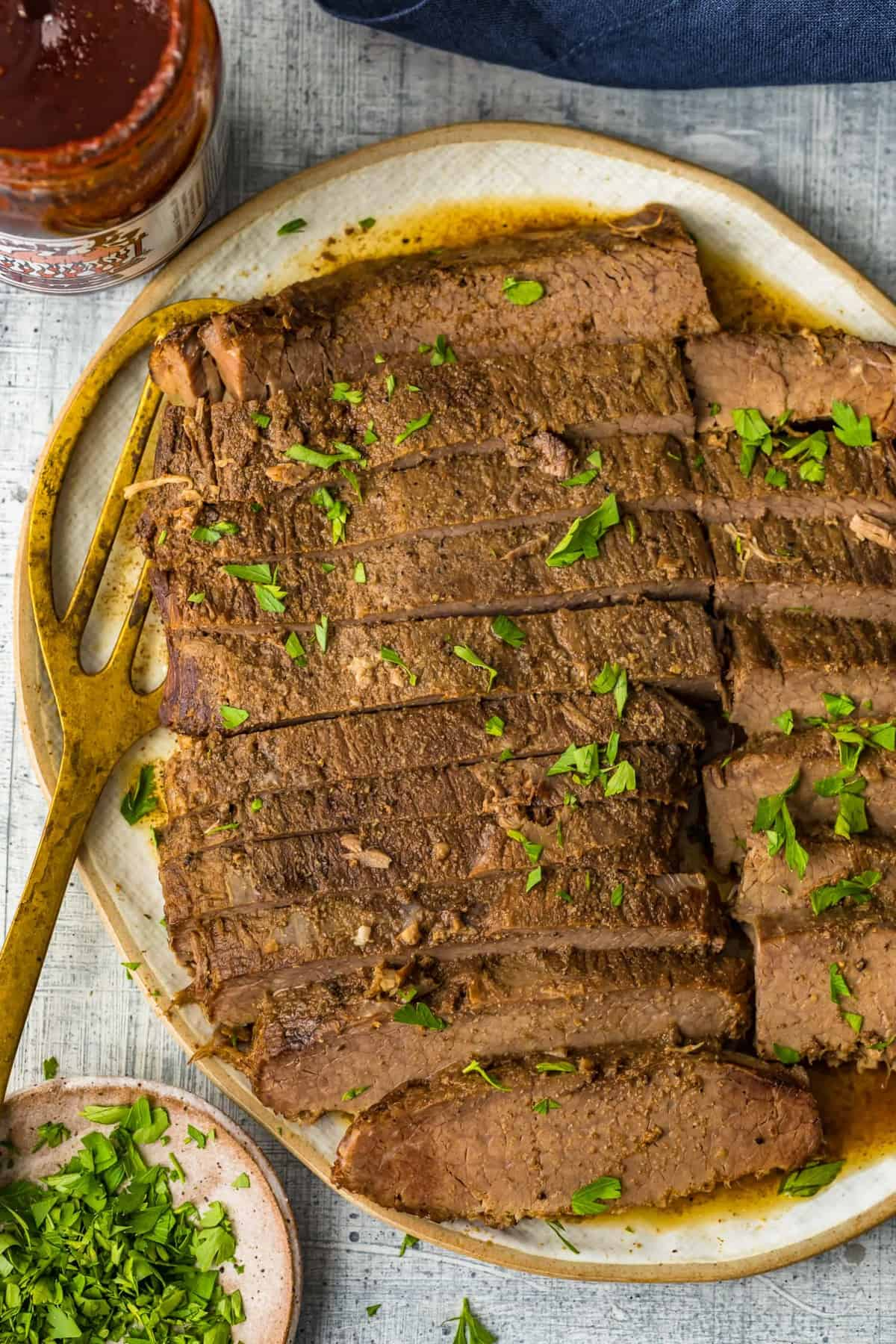 Slow Cooker Brisket garnished with fresh herbs