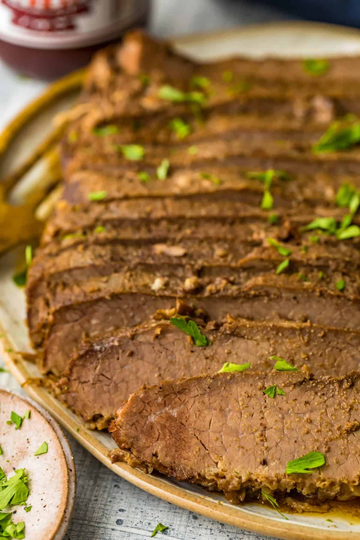 Slices of beef garnished with herbs