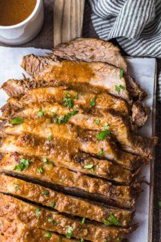 sweet and sour sliced brisket on a platter