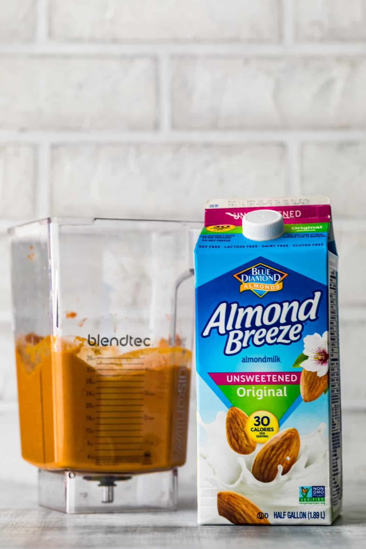 almond breeze next to blender of smoothie