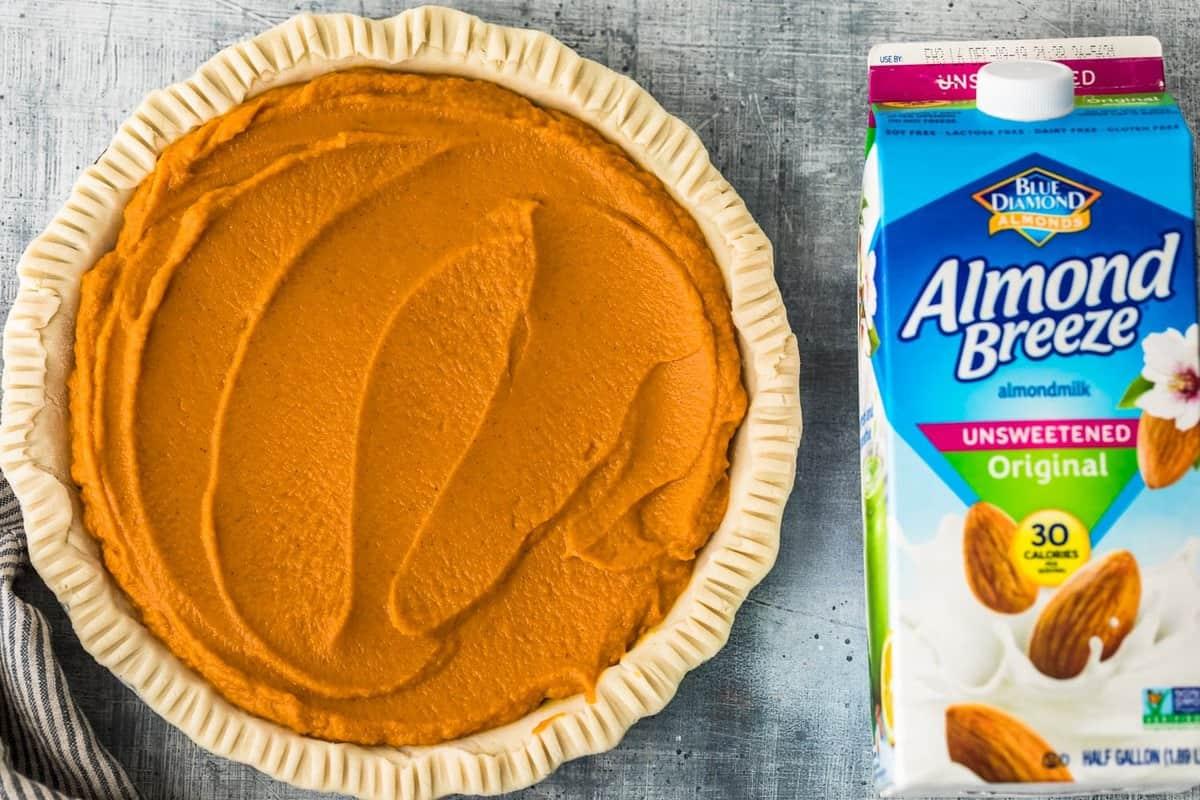 pumpkin pie next to almond breeze carton