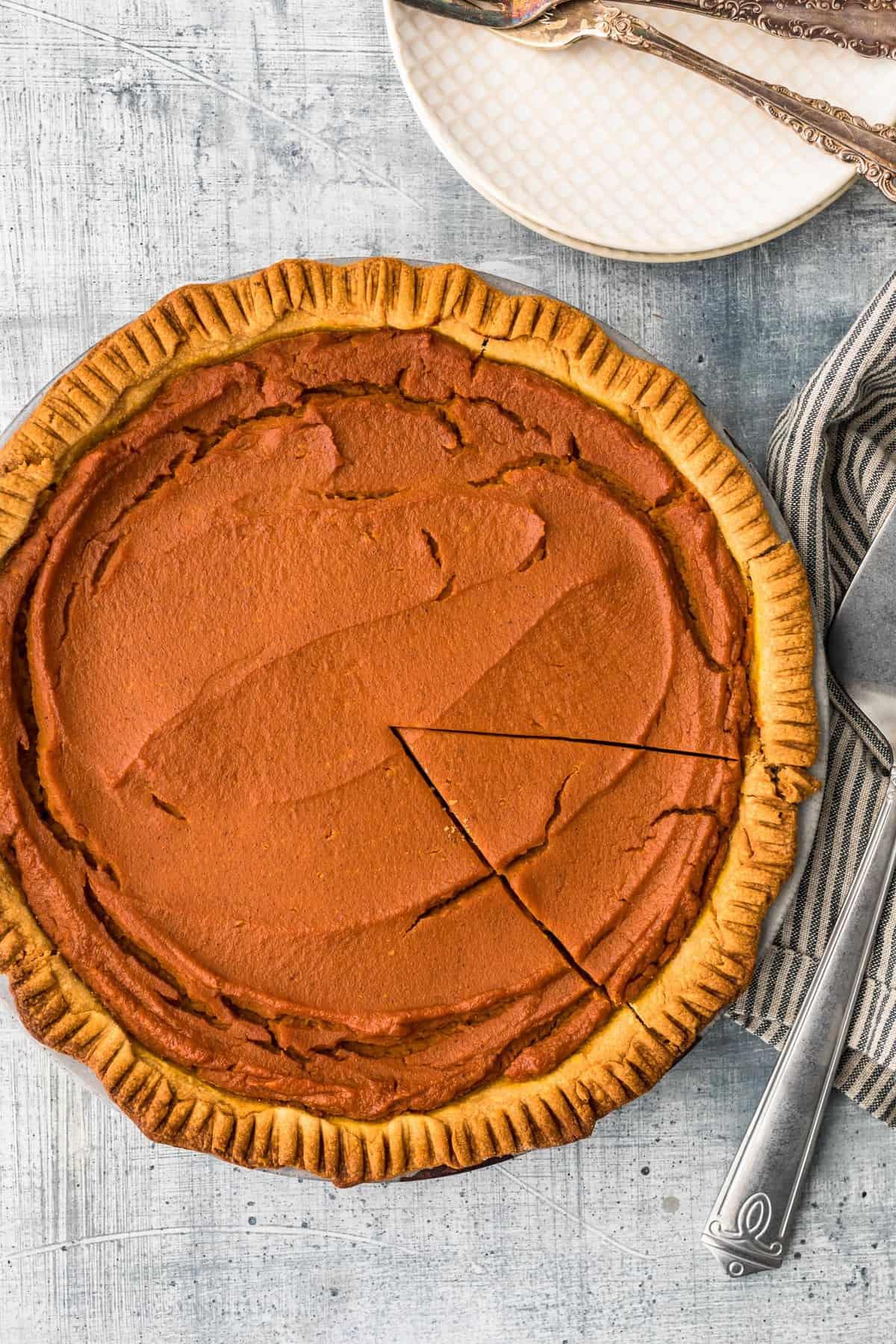 pumpkin pie with slice cut