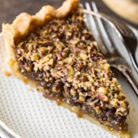 pecan pie slice on a white plate