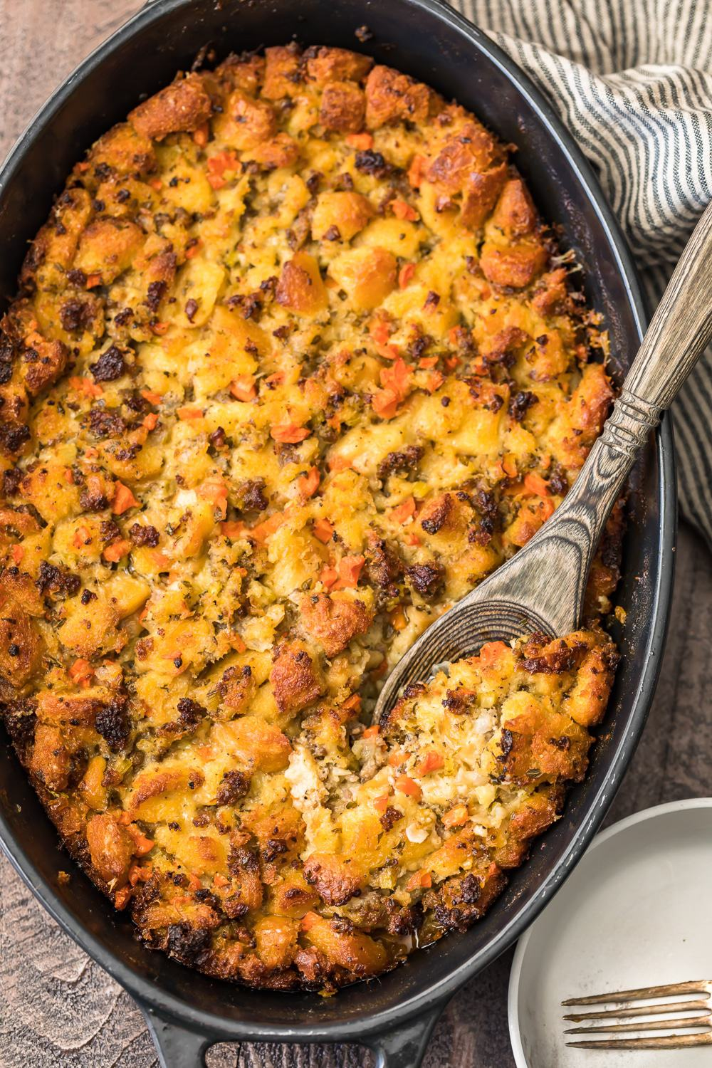 baked sausage stuffing in a black casserole dish