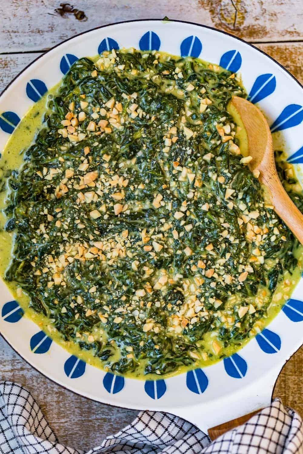 Creamed spinach served in a blue and white bowl