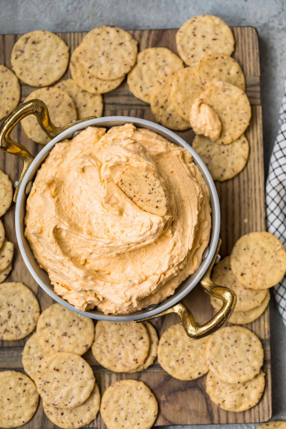 Beer Cheese Dip served in a bowl with piles of crackers