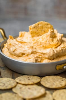 beer cheese dip in a pan with chips