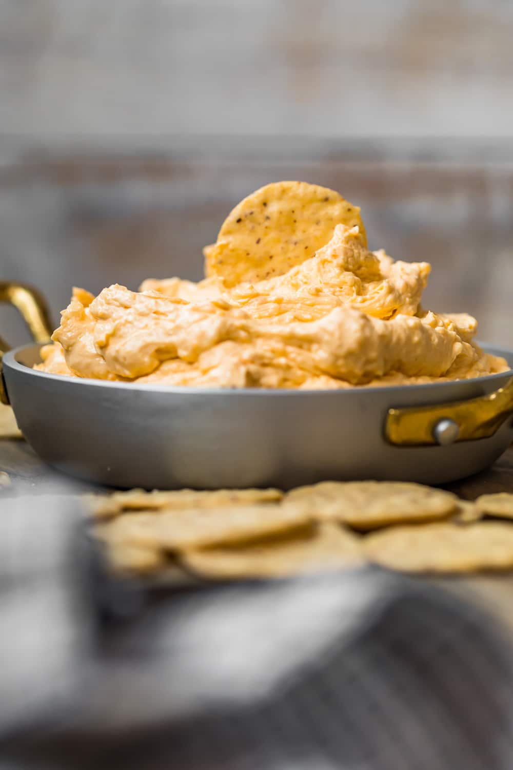 A dip piled high in a silver dish