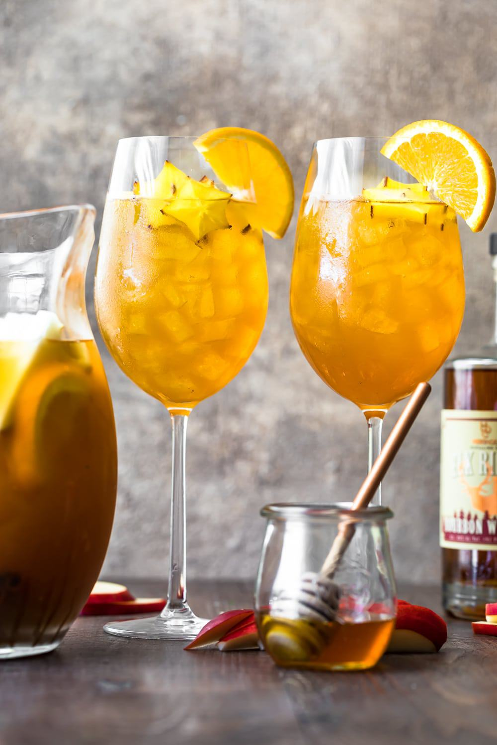 Two glasses of fall sangria with orange slices