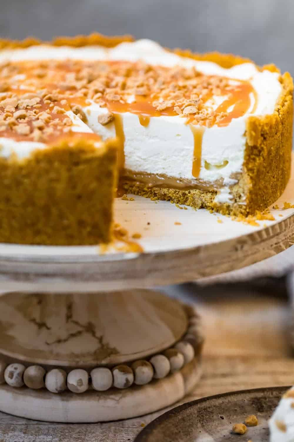 Salted Caramel No Bake Cheesecake on a cake stand