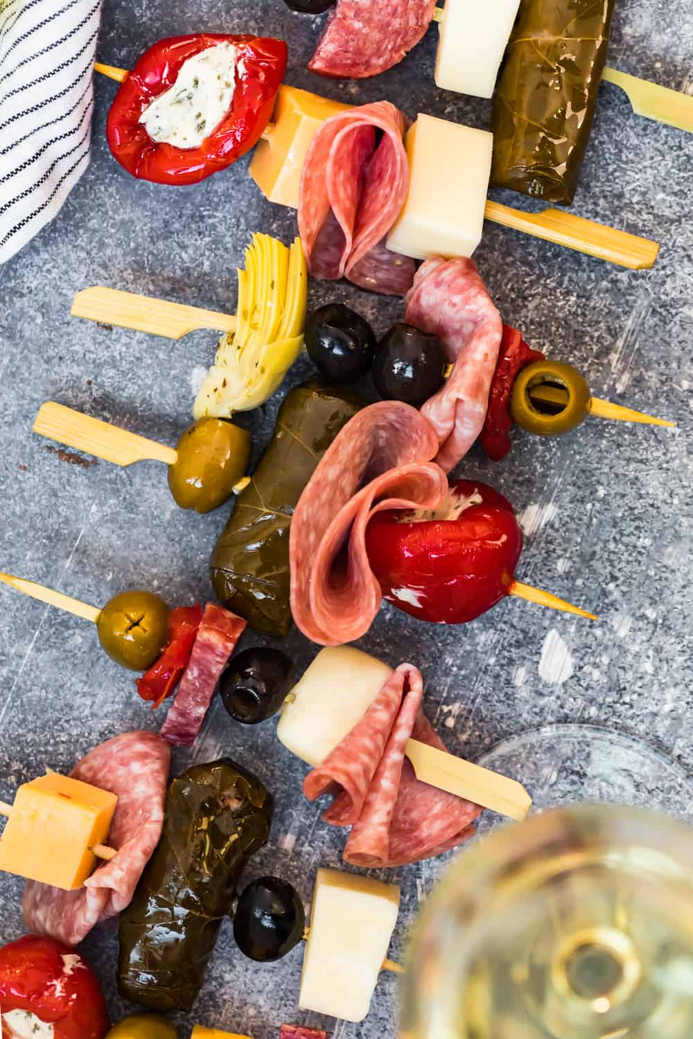 antipasto skewers lined up on a dish