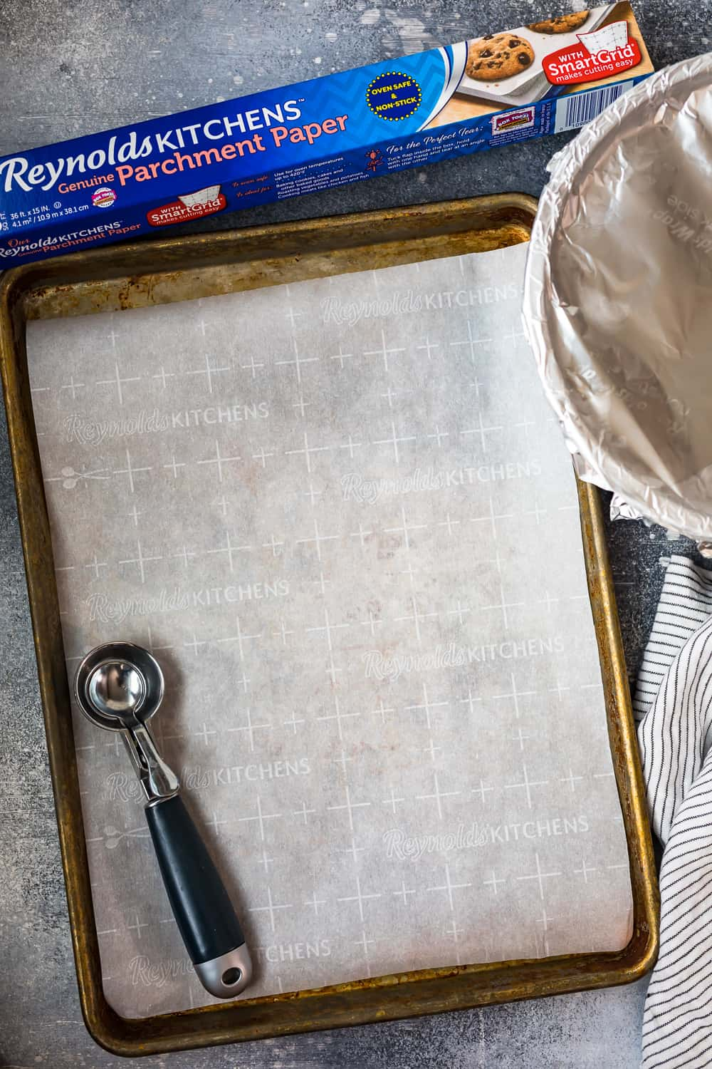 cookie sheet lined with reynolds kitchens genuine parchment paper