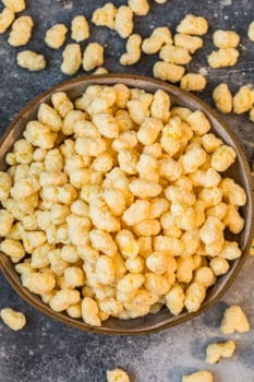 candied corn puff snack mix in bowl