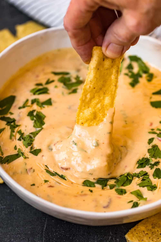 close up of tortilla in crock pot queso