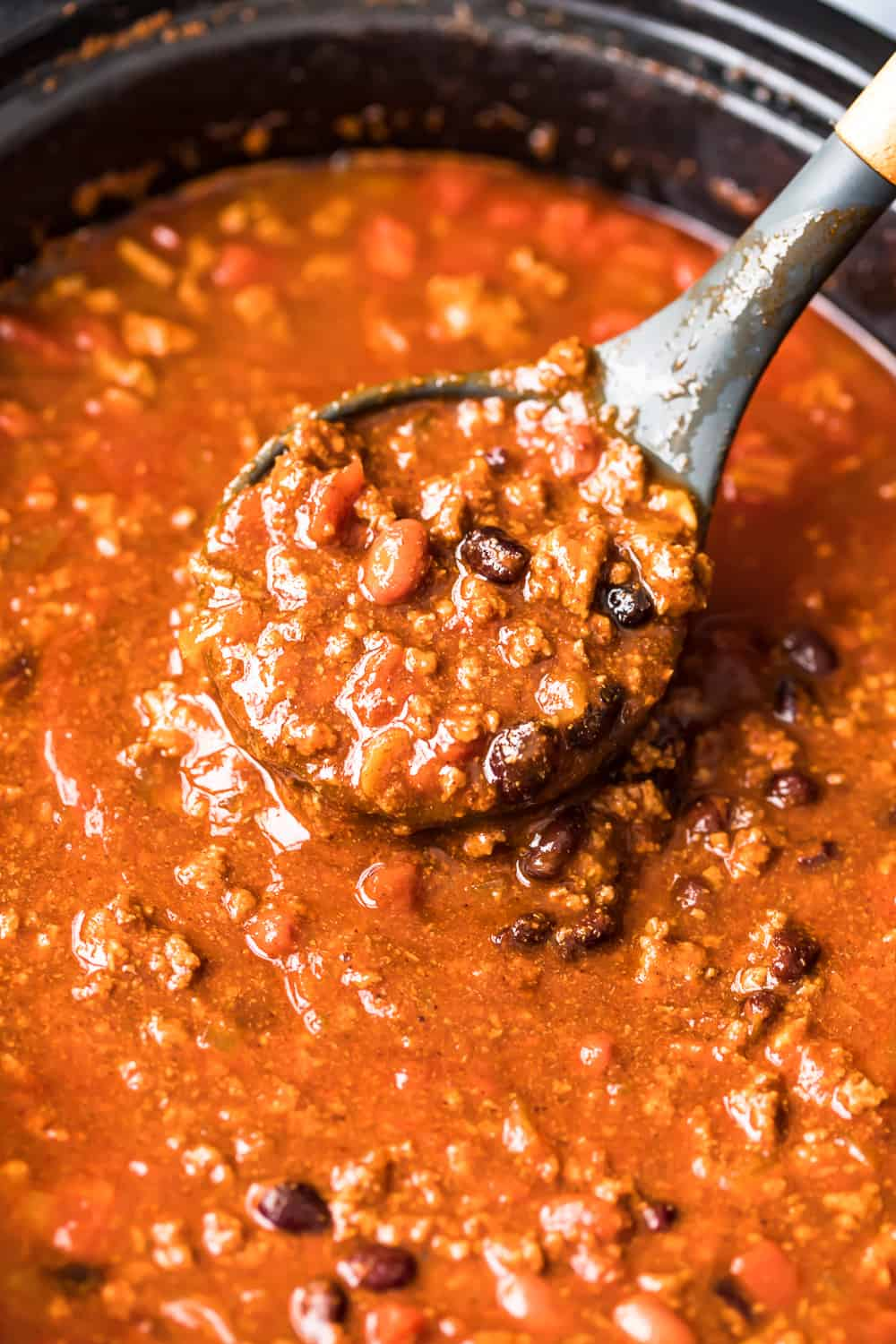 ladle with crockpot chili
