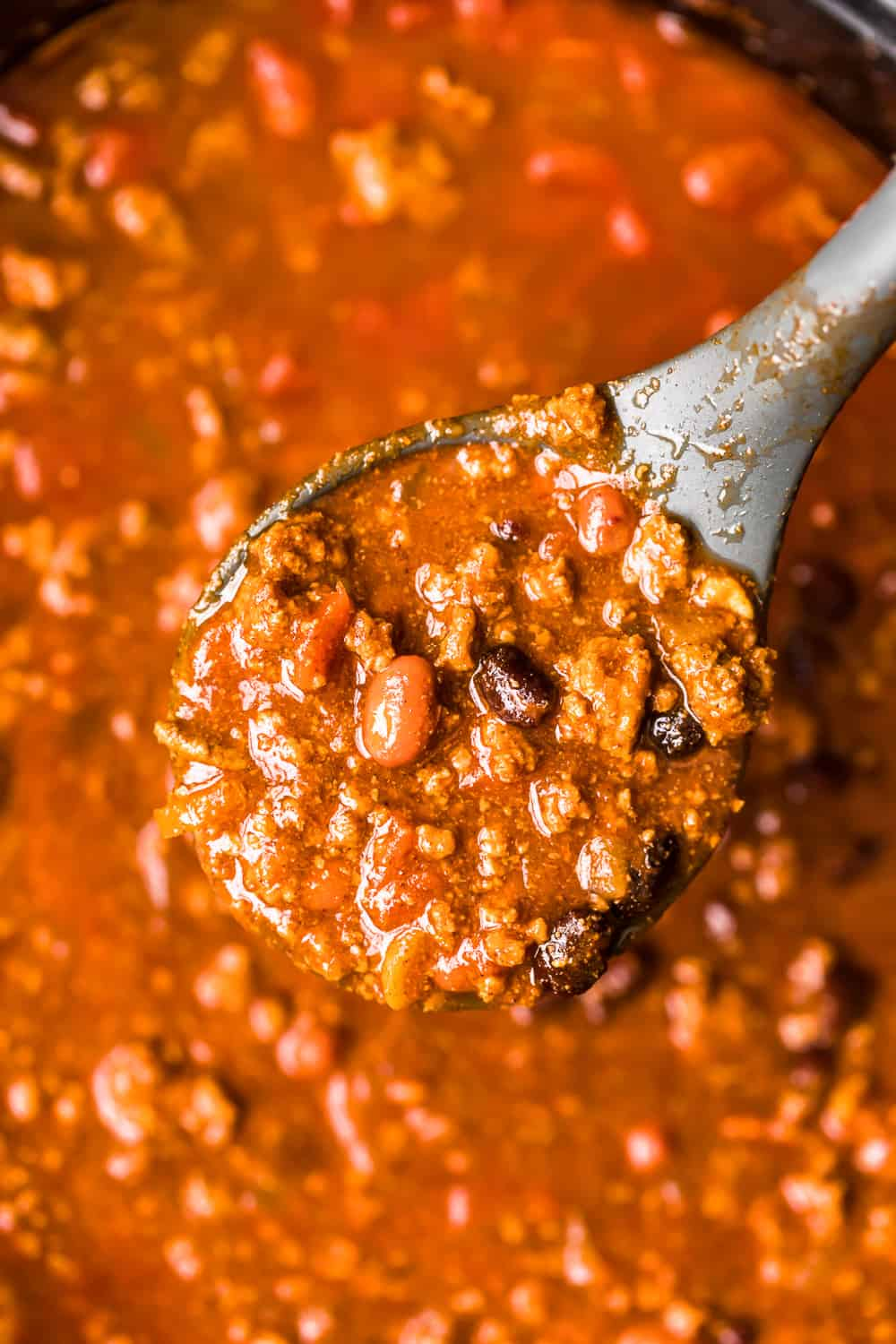 crockpot chili recipe on a spoon