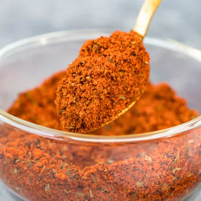 homemade chili seasoning being scooped up with a spoon