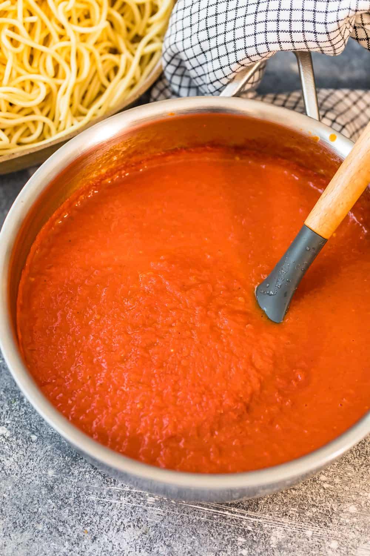 stirring homemade marinara sauce
