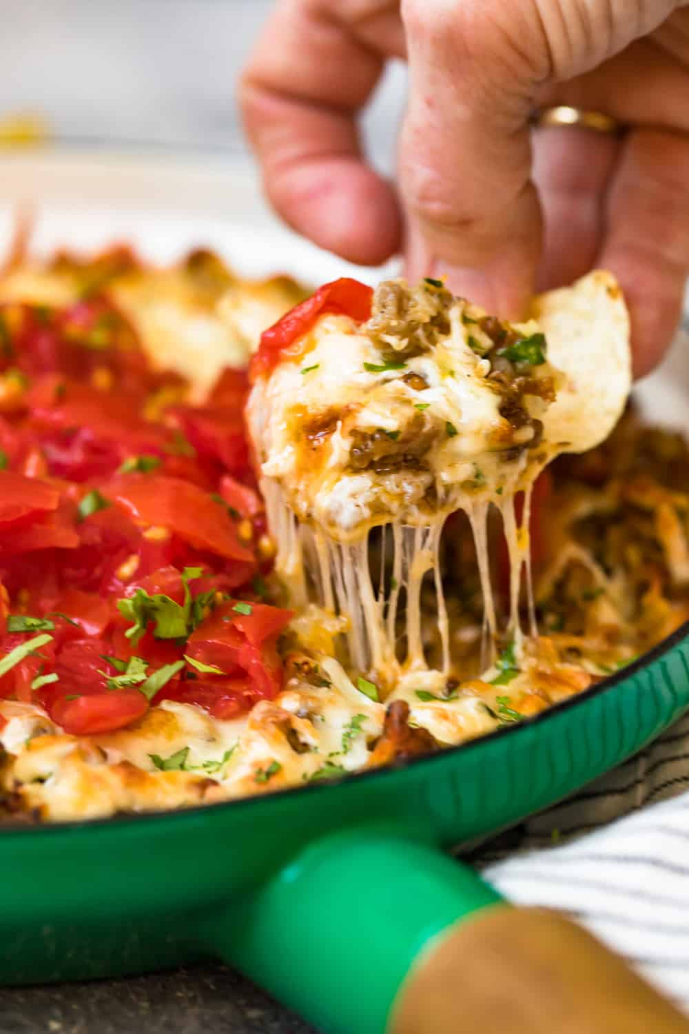 chip in queso fundido dip