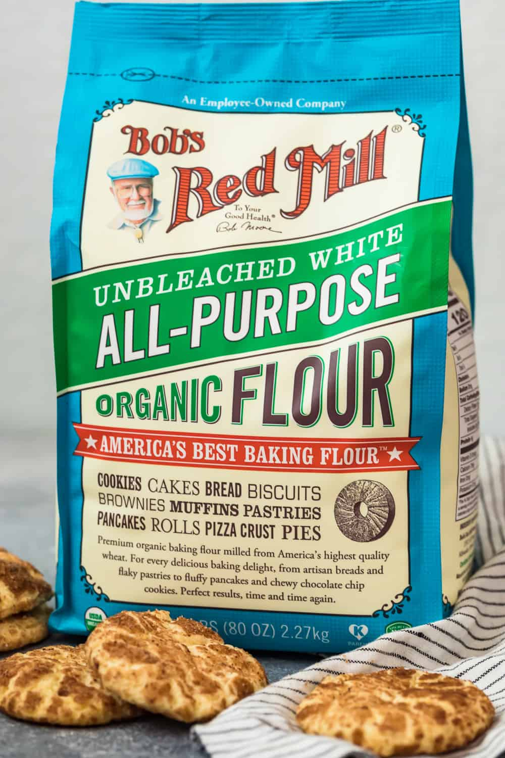 a bag of bob's red mill flour behind some cookies
