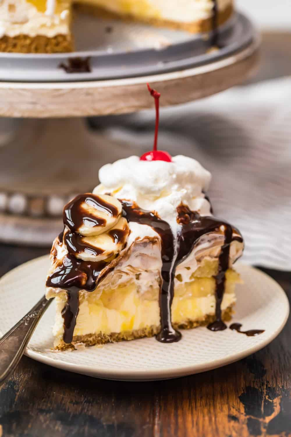 chocolate sauce drizzled on banana split dessert