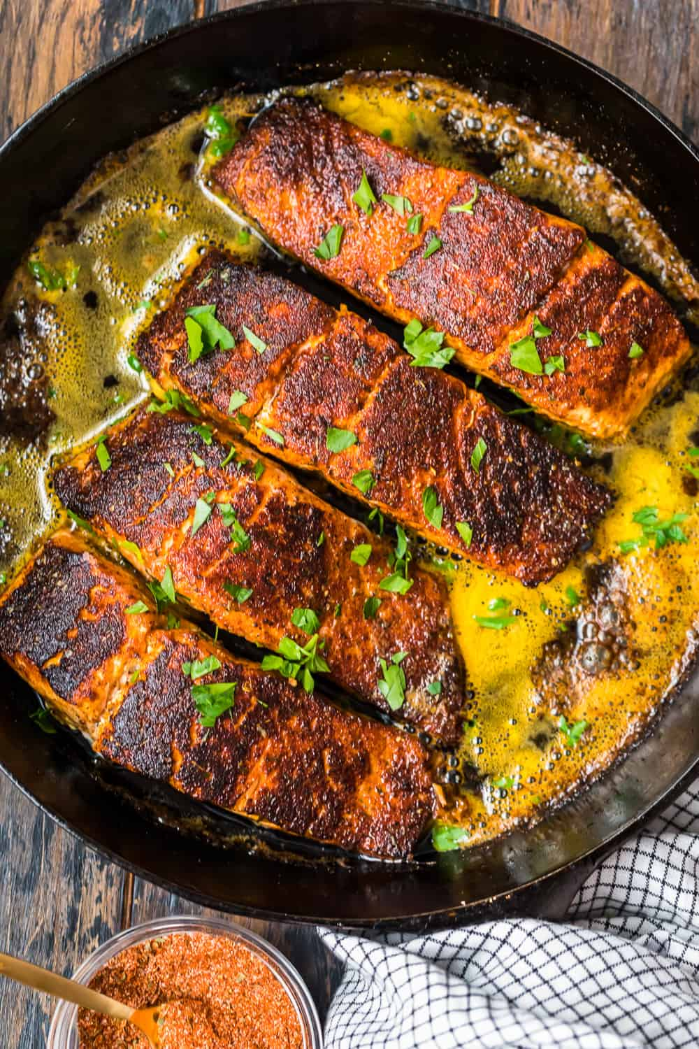 blackened salmons in a skillet