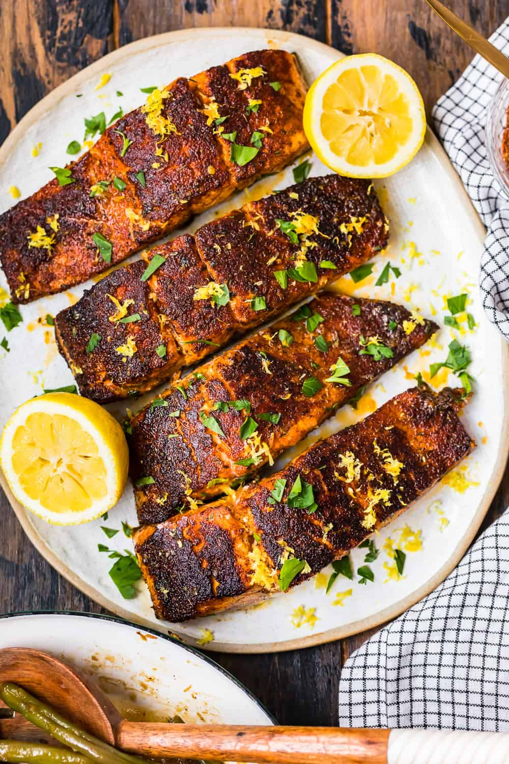 4 salmon fillets on a plate